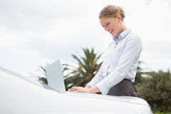 Young businesswoman using laptop Stock Photography