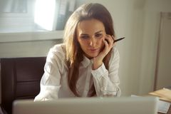 Young businesswoman using laptop in home office Stock Photography