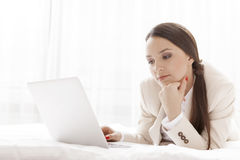 Young businesswoman using laptop in hotel room Royalty Free Stock Image