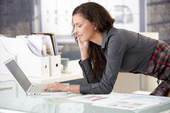 Young businesswoman using laptop in office Royalty Free Stock Photo