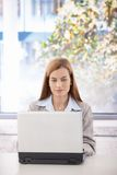 Young businesswoman using laptop in office Royalty Free Stock Images