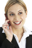 Young Businesswoman Using Mobile Phone Stock Photography