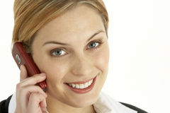 Young Businesswoman Using Mobile Phone Royalty Free Stock Photography