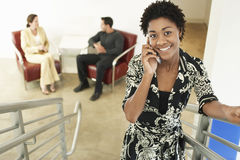 Young Businesswoman Using Mobile Phone On Stairway Stock Images