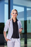Young businesswoman using mobile phone on street Stock Image