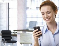 Young businesswoman using mobilephone at office Stock Photo