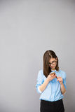 Young businesswoman using smartphone Stock Photography