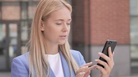 Young businesswoman using smartphone stock video