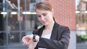Young Businesswoman Using Smartwatch Outdoor. 4k high quality, 4k high quality stock video footage