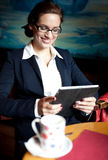 Young businesswoman using tablet computer Royalty Free Stock Image
