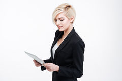 Young businesswoman using tablet computer Royalty Free Stock Photos