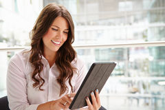 Young businesswoman using tablet computer, waist up Royalty Free Stock Images