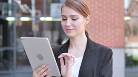 Young Businesswoman Using Tablet Outdoor. 4k high quality, 4k high quality stock footage