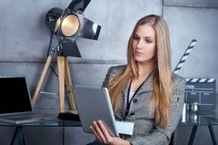 Young businesswoman using tablet Royalty Free Stock Image