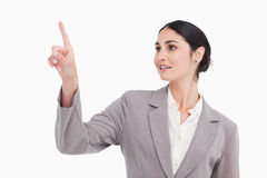 Young businesswoman using touch screen. Against a white background Royalty Free Stock Image