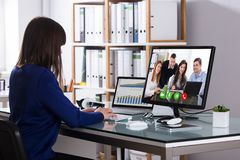 Businesswoman Video Conferencing On Computer stock images