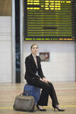 Young businesswoman waiting at the airport. Because the airplane is late Stock Images