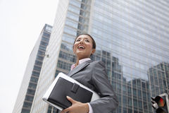 Young businesswoman walking down the street Stock Photo