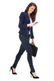 Beautiful businesswoman sending a message on smartphone Royalty Free Stock Photography