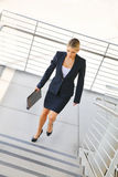 Young businesswoman walking on stairs Royalty Free Stock Image
