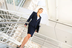 Young businesswoman walking on stairs Royalty Free Stock Photography