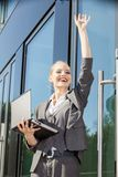 Young businesswoman waving Stock Photography