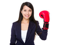 Young businesswoman wear of plastic boxing gloves Royalty Free Stock Photos