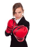 Young businesswoman wearing boxing gloves ready for the competit Royalty Free Stock Image