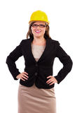 Young businesswoman wearing a hardhat. Young business woman wearing a hardhat. Safe business Royalty Free Stock Photography