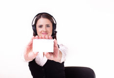Young businesswoman wearing a headset holding out a blank white Stock Photo