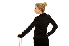 Young businesswoman with wheeled suitcase Royalty Free Stock Photo