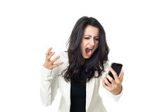 Young businesswoman on white background. Angry businesswoman isolated  on a white background screaming on the phone Royalty Free Stock Photos