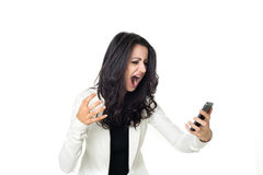 Young businesswoman on white background. Angry businesswoman isolated  on a white background screaming on the phone Royalty Free Stock Image