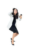 Young businesswoman on white background. Angry businesswoman isolated  on a white background screaming on the phone Stock Photo