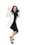 Young businesswoman on white background. Angry businesswoman isolated on a white background screaming on the phone Stock Photography
