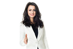 Young businesswoman on white background. Businesswoman isolated on a white background gesticulating with hands Stock Photo