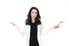 Young businesswoman on white background. Businesswoman isolated  on a white background gesticulating with hands Stock Photography