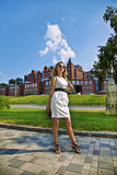 The young businesswoman in white dress. In the city Stock Photography