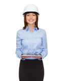 Young businesswoman in white helmet with tablet pc Stock Photo