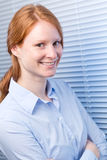 Young Businesswoman by a Window Stock Photography