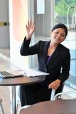 Young businesswoman woman say hi to friend Royalty Free Stock Photo