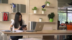 Young businesswoman at work stock footage