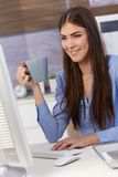 Young businesswoman at work with coffee stock image