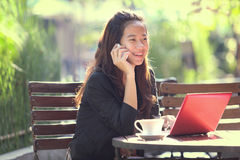 Young businesswoman work oudoor, in a cafe Stock Photos