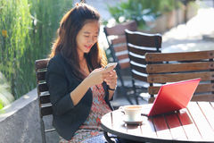 Young businesswoman work oudoor, in a cafe Stock Image
