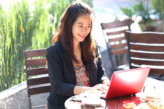 Young businesswoman work oudoor, in a cafe Stock Images