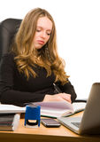 Young businesswoman working. Young businesswoman writting in notebook royalty free stock photography