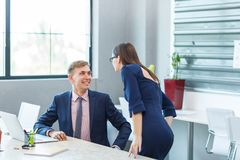 Young businesswoman working with beautiful secretary and laptop. Stock Photos