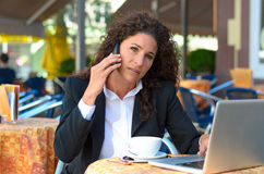 Young businesswoman working at a cafe Royalty Free Stock Image