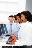 Young businesswoman working in a call center royalty free stock photo